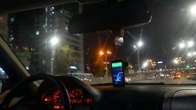 Night city taxi car. Night city traffic inside taxi car