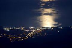 Night city of Tekirova in Turkey with moonlight on the sea