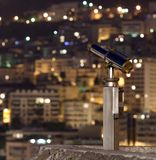 Night city with a telescope Royalty Free Stock Photo