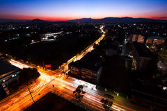 Night city traffic. Intersect Night city traffic in twilight time at Chiang Rai city Stock Photos