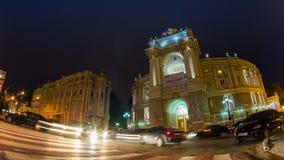 Night city traffic timelapse with zoom  near Opera House in Odessa, Ukraine. Full HD stock footage
