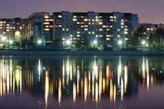 Night city in Ukraine. Night city reflected in the water. Cherkasy, Ukraine stock photography
