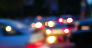 Night city urban traffic with defocused cars. Car headlights blurred stock footage