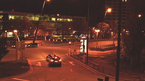 Night City. Video is nigttime timelapse of cars and ligts and trafic ligts and lights and bright people go arround and arround and have a good night in winter stock footage