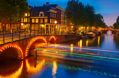 Night city view of Amsterdam canal and bridge Royalty Free Stock Photos