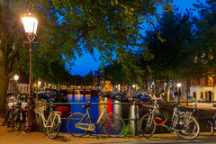 Night city view of Amsterdam canal and bridge royalty free stock photography