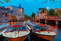 Night city view of Amsterdam canal stock photos