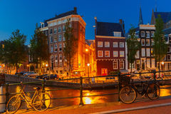 Night city view of Amsterdam canal and bridge Royalty Free Stock Photo