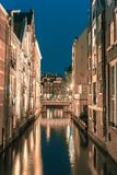 Night city view of Amsterdam canal and bridge stock photos