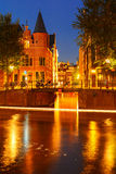 Night city view of Amsterdam canal and bridge Stock Image