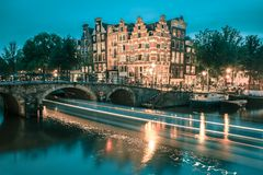 Night city view of Amsterdam canal and bridge Royalty Free Stock Images