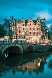 Night city view of Amsterdam canal and bridge stock photography