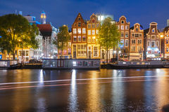 Night city view of Amsterdam canal with dutch houses Stock Photography
