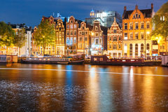 Night city view of Amsterdam canal with dutch houses Royalty Free Stock Photography