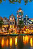 Night city view of Amsterdam canal with dutch houses Royalty Free Stock Images