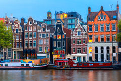 Night city view of Amsterdam canal with dutch houses Royalty Free Stock Photos