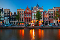 Night city view of Amsterdam canal with dutch houses Stock Images