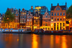 Night city view of Amsterdam canal with dutch houses Stock Image