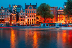 Night city view of Amsterdam canal royalty free stock photography