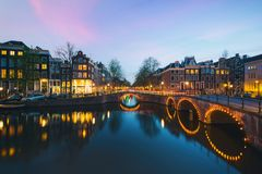 Night city view in Amsterdam, Netherlands. Canal and typical dut royalty free stock photo