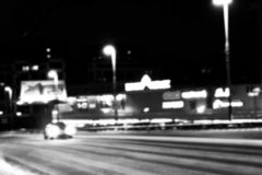 Night city view in blur. City Speed Traffic blurry photo. Street life bokeh image. Street view with traffic and cars defocused ima. Night city view in blur. City royalty free stock image