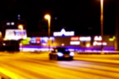 Night city view in blur. City Speed Traffic blurry photo. Street life bokeh image. Street view with traffic and cars defocused. Image. Road in big city bokeh Stock Photography