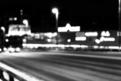 Night city view in blur. City Speed Traffic lights blurry photo. Street life bokeh image. Street with traffic and cars defocused i. Mage. Road in big city bokeh Stock Images