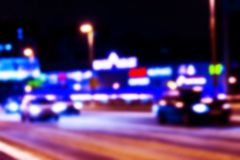 Night city view in blur. City Speed Traffic blurry photo. Street life bokeh image. Street view with traffic and cars defocused. Image. Road in big city bokeh Royalty Free Stock Photo