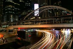 Night city view of cars under modern bridge in downtown at night stock photos