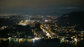 Night city view timelapse. Night city view from observation deck to Como and Chernobbio cities in Italy near Milan. Como Lake in front. Glowing city roads stock video