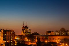 Night city Voronezh, Russia, Annunciation Cathedral among other buildings and houses Royalty Free Stock Photo
