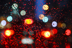 Night city through windshield. Street Bokeh Lights Out Of Focus. Royalty Free Stock Photo