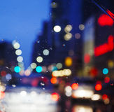 Night city through windshield. Street Bokeh Lights Out Of Focus. Royalty Free Stock Image