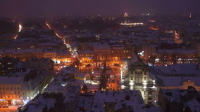 Night city winter snow evening roof landscape stock footage