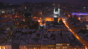 Night city winter snow evening roof landscape stock video footage