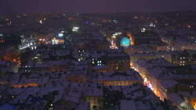 Night city winter snow evening roof landscape stock video