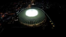 Night cityscape, amazing soccer arena during match, urban lights, aerial view. Stock footage stock footage