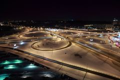 Night cityscape with big interchange. Night winter cityscape with big interchange, lighting columns and garages,black sky Royalty Free Stock Photography