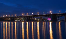 Night cityscape of the bridge. Night scene of the bridge with light reflections in the river Royalty Free Stock Images