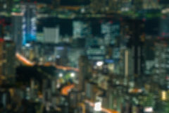 Night cityscape buildings blue orange blur Stock Image