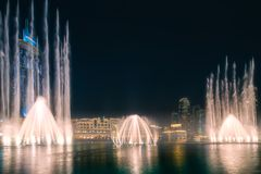 The night cityscape with dancing fountain of Dubai. UAE royalty free stock images