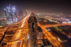 Night cityscape of Dubai with modern futuristic architecture , United Arab Emirates Stock Photo