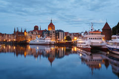 Night cityscape of Gdansk. Buildings of the old town Gdansk reflected in a water in evening Stock Photography