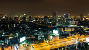 Night cityscape with golden highway. Royalty Free Stock Images