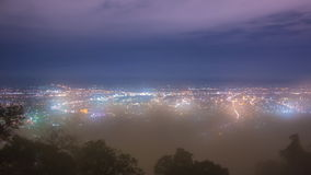 Night Cityscape And Mist Floating Over Of Chiang Mai, Thailand. Time Lapse Night Cityscape And Mist Floating Over Of Chiang Mai, Thailand stock video footage