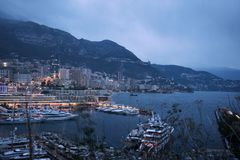 Night cityscape of Monte Carlo by marina, riviera of Monaco. Mar royalty free stock images