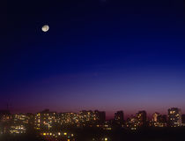 Night cityscape with moon. Royalty Free Stock Photography