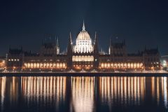 Night cityscape of the Parliament building on the Danube riverbank in central Budapest  capital of Hungary Stock Photos