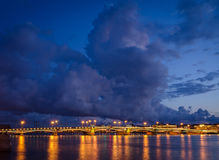 Night cityscape with river and bridge in Saint-Petersburg. Stock Photo