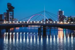 Night cityscape on the River Clyde. Night cityscape with two bridges on the river Clyde, Millennium Bridge and The Clyde Arc, Glasgow, Scotland Royalty Free Stock Photo